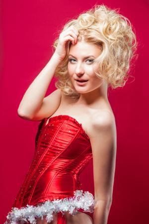 sexy christmas elf: beautiful blonde sexy cheerful santa helper girl