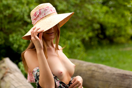 hat nude: Pretty Blond woman with hat nude in the forest
