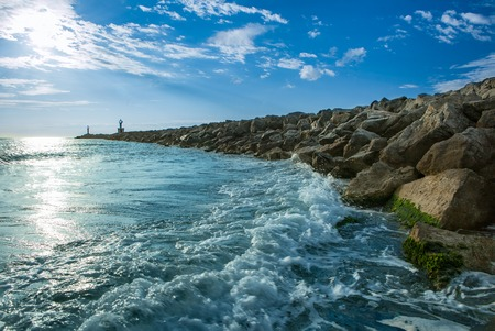 large rocks: Bay on the coast at France with large rocks as a breakwater on the Mediterranean Sea Stock Photo