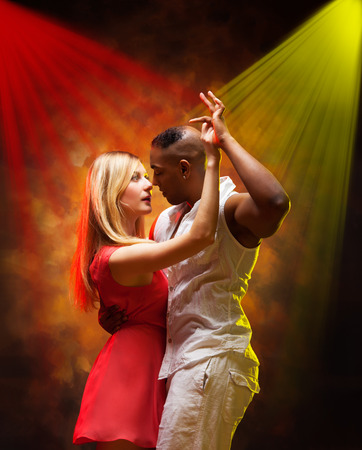 Young and sexy couple dances Caribbean Salsa photo