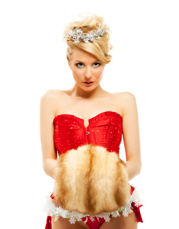 beautiful blonde sexy girl wearing santa claus clothes photo