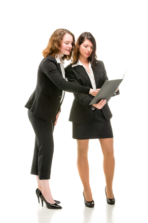 Two young business women in full li Stock Photo - 80608513