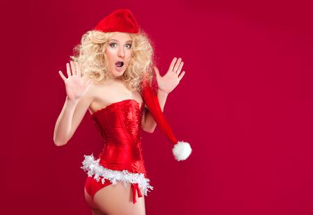 beautiful blonde girl wearing santa claus clothes Stock Photo