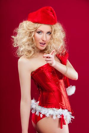 beautiful blonde sexy girl wearing santa claus clothes 版權商用圖片