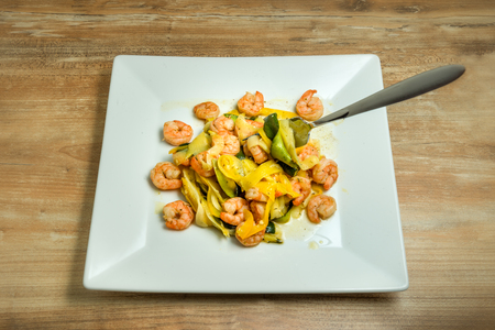 Plate with homemade shrimp scampi zucchini noodles. Stock Photo