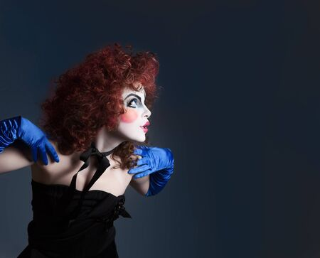 Woman mime with theatrical makeup. Studio shot. Stock Photo