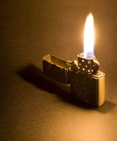 A Zippo Lighter With Flames Stock Photo