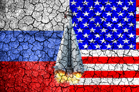 third world: Flag of Russia and USA painted on the cracked wall. Concept of war. Cold war. The arms race. Nuclear war. The third world war. The conflict between Russia and America. Political concept. Front view.