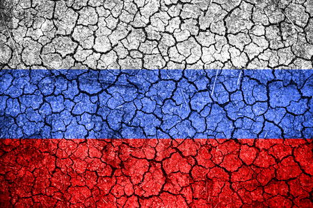 famine: Flag of Russia painted on cracked wall. Political concept. Old texture. Vintage design. USA flag on cracked earth. Famine and drought. Natural disaster.