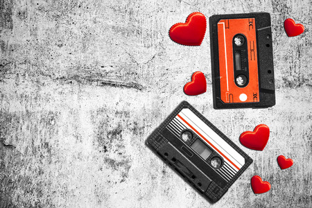 yesteryear: Old audio cassette. Multicolored audio tapes. Close-up view. The concept of old music. The era of retro songs. Isolated objects. The music of yesteryear.