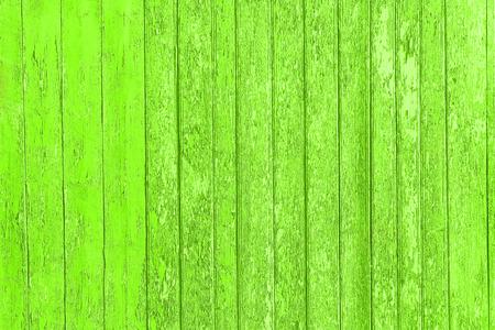 ひびの入った色塗料、背景古いパネルで古いぼろぼろの木製の板。カラー皮ウッド テクスチャ。破壊の壁。荒廃した床。破壊された木製の壁のテク