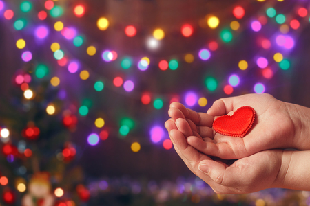 Do good things. Create well deeds. Charity and miracle. Christmas and New year mood. Festive background. To make people happy. Xmas miracle. Charitable foundation. Helping hand. Give love. Holiday. Stock Photo