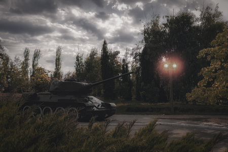 Tank at the street of city. Concept of military action and armed attack. War.