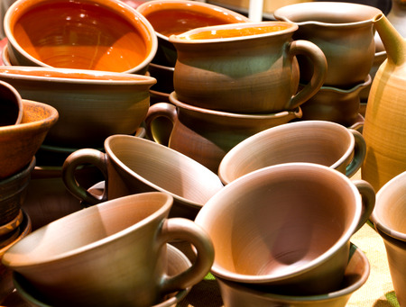 loamy: Handmade traditional russian ceramics (crockery, things, ware, jugs, pots) on the shopboard at the flea market in Moscow (Russia). Stock Photo