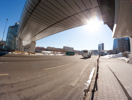 footbridge: Bagration bridge in Moscow city, a russian architecture landmark that combains a foot-bridge (flyover or pedestrian crossing) of modern contemporary construction and a mall