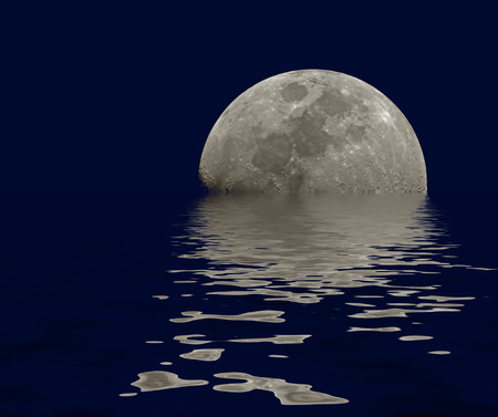 Moon near the sky line at the dark sky with its reflection in wavy water. photo