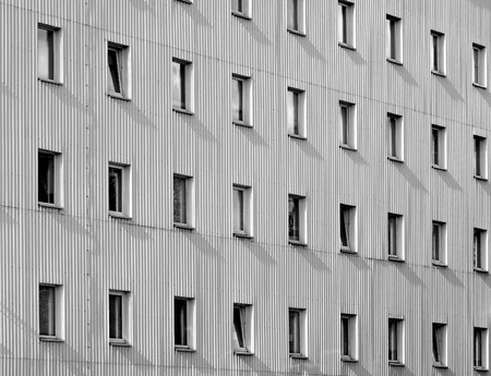 alluminum: Modern architecture abstract geometric backgroung: building facade with alluminum panels as a siding and number of windows. Can be used as a wallpaper. Stock Photo