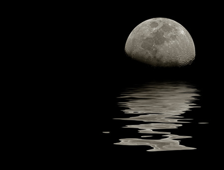 Moon near the horizon (sky line)  with its reflection in wavy water. There is a copy space to insert some text or images. Can be used as a postcard, background or wallpaper. photo