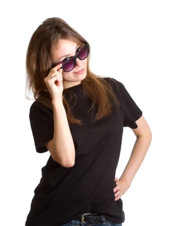 Portrait of an attractive beautiful pretty cute successful young caucasian woman (lady, girl, female, person, model) closeup with right hand holding her sunglasses (spectacles, specs) staring at you (sight directed straight forward) and smiling. Isolated  photo
