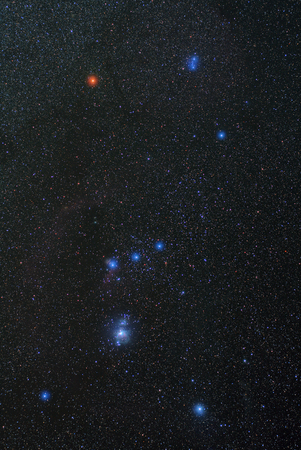 orion: Universe space image: real photo of starry dark night sky with the winter Orion constellation. The shot was done with total exposure time 54 minutes. Several nebulae are clearly visible. Can be used as a background, backdrop or wallpaper Stock Photo