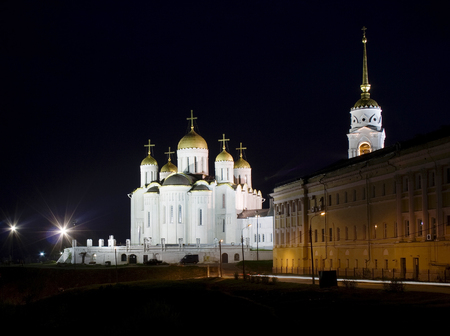 alight: Orthodox Cathedral night: ancient Assumption Cathedral in Vladimir (one of the famous landmark in Russia) representing a bright example of old Russian architecture at an summer night alight  illuminated by lanterns  lamps with dark black sky as a backgr