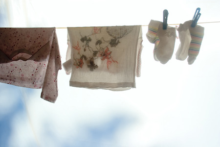 launder: ?hildrens clothes after washing getting dry.