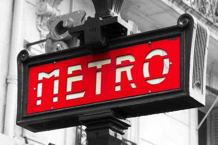 Red street sign which indicates an entrance in metro in Paris, france