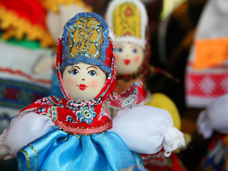 Desk at the flea market: handmade rag doll woman, in traditional ethnic russian costume