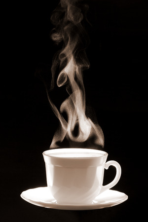White cup coffee with steam consisted of little water  drops on a dark black background.