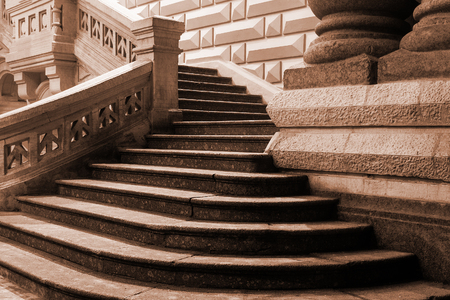 Entrance in an old architecture historic public buildind with granite staircase and columns.