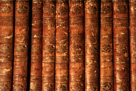 Antique vintage old retro worn grunge brown books by Lord Byron in row on bookshelf.