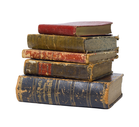Antique vintage old retro worn books in stack isolated on white background / backdrop.