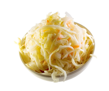 Sauerkraut with carrot is traditional russian appetizer shown here isolated on white background.