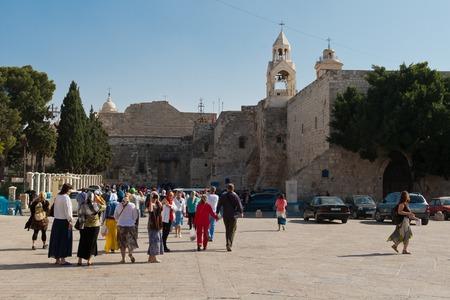 believers: Bethlehem, Palestine - November, 20, 2012: Pilgrims at the Church of the Nativity