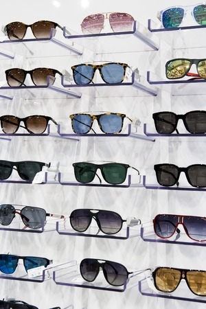 Sunglasses for sale, placed on the shelves, vertical formation