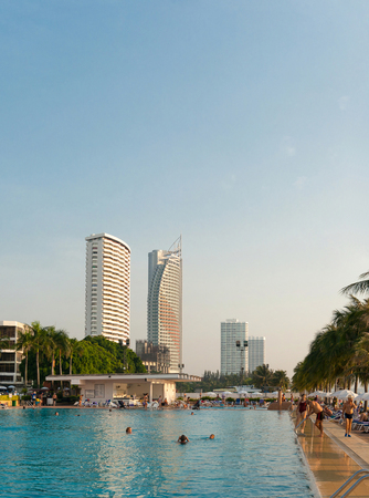 Pattaya, Kingdom of Thailand, December 03, 2018: - People relax by the pool at the Ambassador City Jomtien hotel