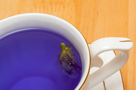 A cup of blue flower tea, close up