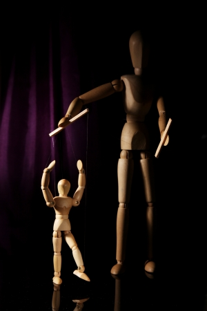 puppeteer with wooden puppet photo