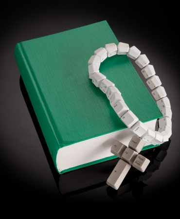 Christian, catholic rosary made from computer keyboard with green book photo
