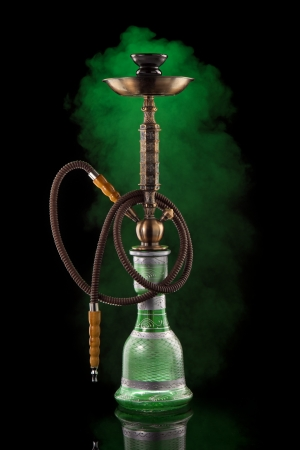 Hookah with smoke on black photo