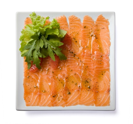 Salmon carpaccio served on white plate  Top view, isolated, with clipping path photo