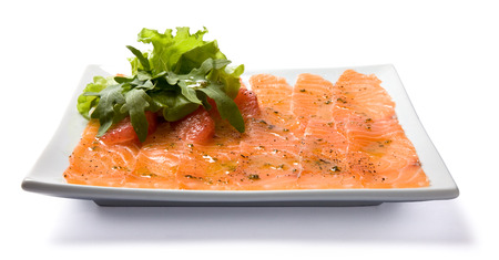 Salmon carpaccio served on white plate. photo