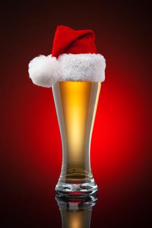 christmas hats: Christmas beer mug. Studio shot. Gradient background