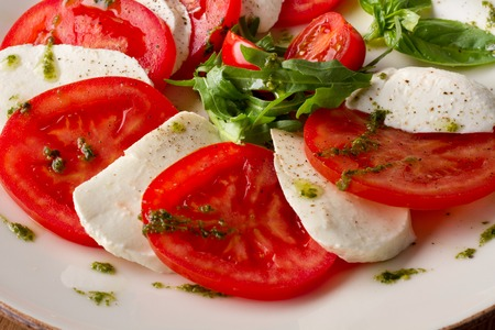 caprese: Caprese salad photo on white dish