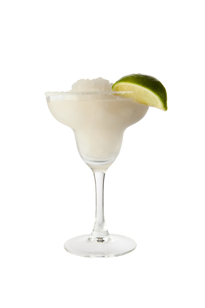 bartending: Classic margarita cocktail with lime slice and salty rim. Isolated on white background Stock Photo