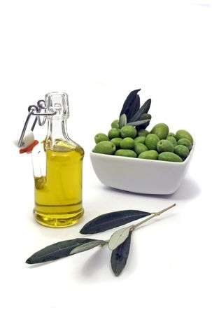 Olive oil and fresk green olives photo