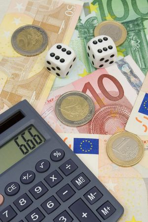 calculated: Investment risk - dices, money and calculator Stock Photo