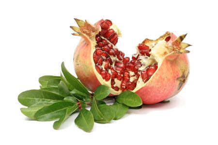 pomegranate juice: Ripe pomegranate isolated on white Stock Photo
