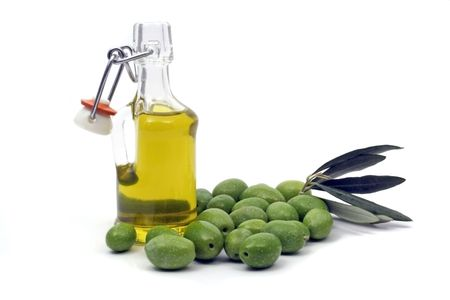 Olive oil and green olives photo