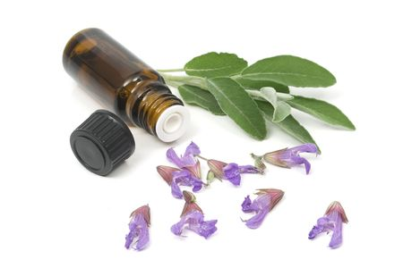 Sage flowers and essential oil bottle used for aromatherapy Stock Photo